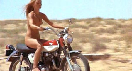 A naked hippie babe on a chopper!
